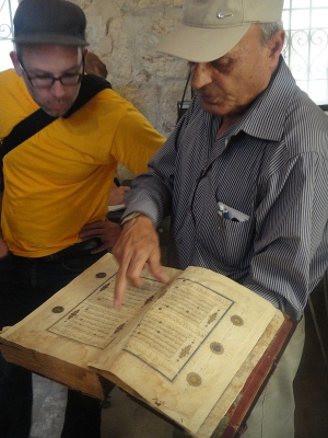 Examining rare books at the Khalidi Family Library, East Jerusalem